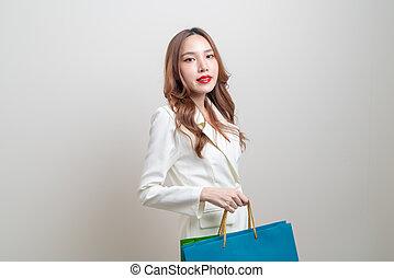 portrait beautiful Asian woman holding shopping bag