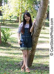 Portrait Beautiful asian woman in Park