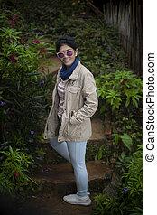 portrait beautiful asian woman standing in garden
