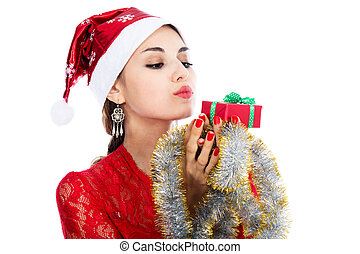 Portrait beautiful christmas woman is holding red gift in studio