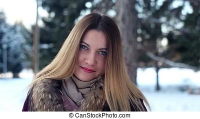 Portrait. Beautiful cute winter girl in the park