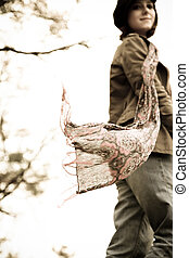 Portrait beautiful girl with scarf. Photo in old image style.