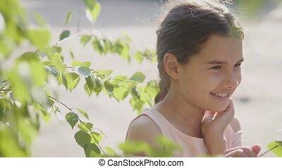 portrait beautiful little girl Russia twig birch tree leaves...