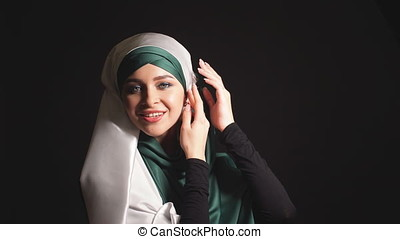 Portrait beautiful muslim girl in hijab looking in camera.