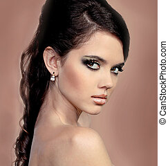 Portrait beautiful woman with perfect makeup wearing jewelry