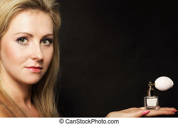 portrait beautiful woman with perfume bottle