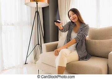 Portrait beautiful young asian women change channel tv