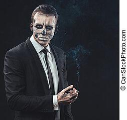 portrait businessman smoking with makeup skeleton - portrait...
