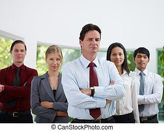 portrait businesspeople smiling and looking at camera