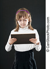 Portrait child with digital tablet