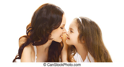 Portrait close-up happy smiling mother with little child daughter looking at each other isolated on white background