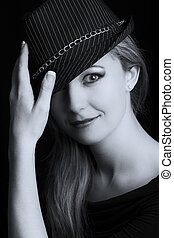 Portrait close-up of a beautiful blond woman with black hat artistic conversion