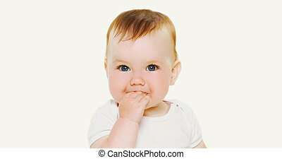 Portrait close up of cute baby isolated on a white background