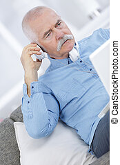 portrait closeup on a man at phone