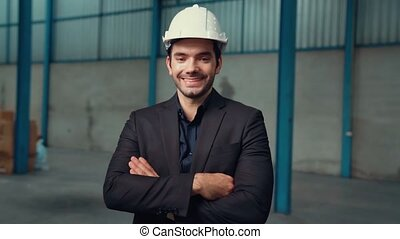 Portrait confident factory manager wearing suit and safety ...