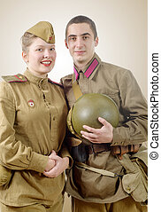 Portrait couple in Russian military uniform of the Great...
