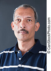 portrait cuban - portrait of a Cuban middle age man on dark...