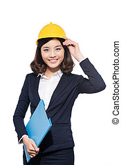 Portrait femme architecte jeune debout casque for Jeune architecte