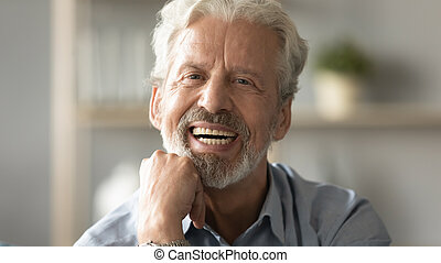 Portrait elderly man with candid wide smile looking at ...