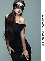 portrait elegant sexual  brunette woman is in a black lace mask