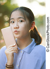 portrait face of asian teenager happiness emotion with...