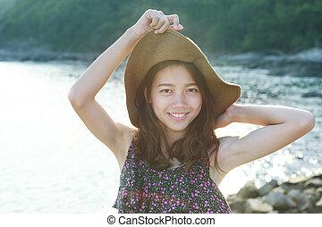 portrait face of beautiful woman wearing wide straw hat...