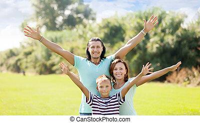 portrait, famille heureuse, trois