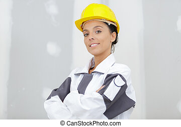 portrait female engineer posing with arms crossed