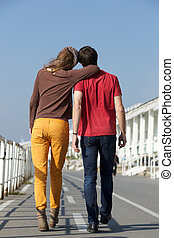 Portrait from behind of young man and woman walking