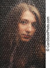 portrait girl behind bubble wrap
