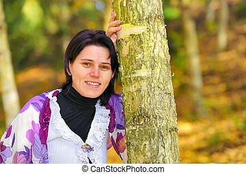 Portrait girl in an autumn park