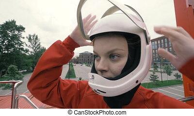 Portrait girl in protective helmet slow motion. Young woman in protective helmet