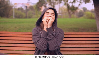 portrait girl shows heart outdoors - young woman showing...