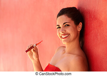 Portrait Girl Smiles Electronic Cigarette E-Cig Against Red Background