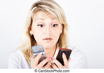Portrait girl with two mobile phones