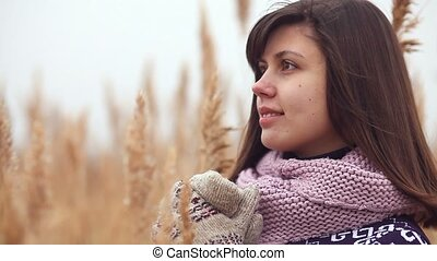portrait girl woman in sweater scarf and mittens nature...