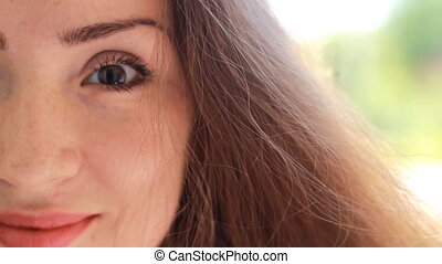 Portrait half face closeup beautiful young woman with brown...