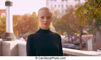 portrait happy blonde in town - young caucasian woman with...