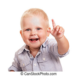 Portrait happy boy in bright shirt with raised hand isolated.