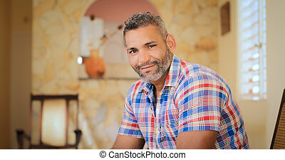 Portrait Happy Gay Man Looking At Camera Indoors