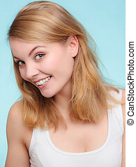 Portrait happy girl smiling woman on blue. Dental. -...