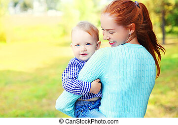 Portrait happy smiling mother and son child outdoors in park