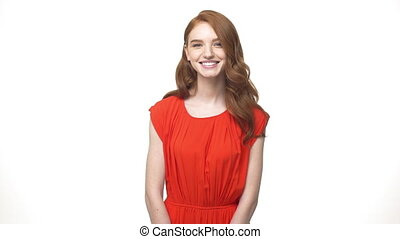 Portrait happy young causcasian woman in orange gorgeous dress making heart shape with hands.