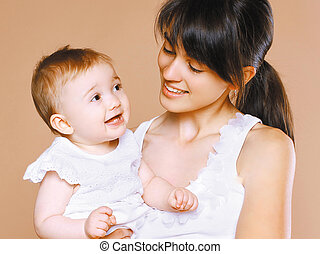 Portrait happy young mom and child
