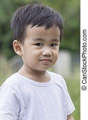 portrait head shop of asian children smiling face standing outdoor
