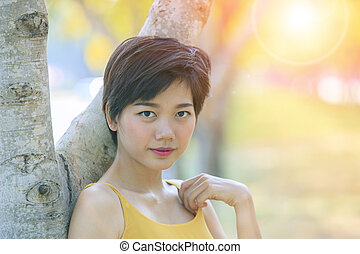 portrait head shot of young asian beautiful woman in park
