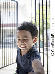 portrait headshot of asian children toothy smiling face happiness emotion