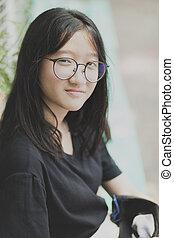 portrait headshot of asian wearing eye glasses smiling face