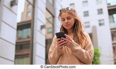 portrait hipster girl using smartphone