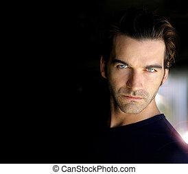 Portrait in black - Closeup portrait of a sexy male model...